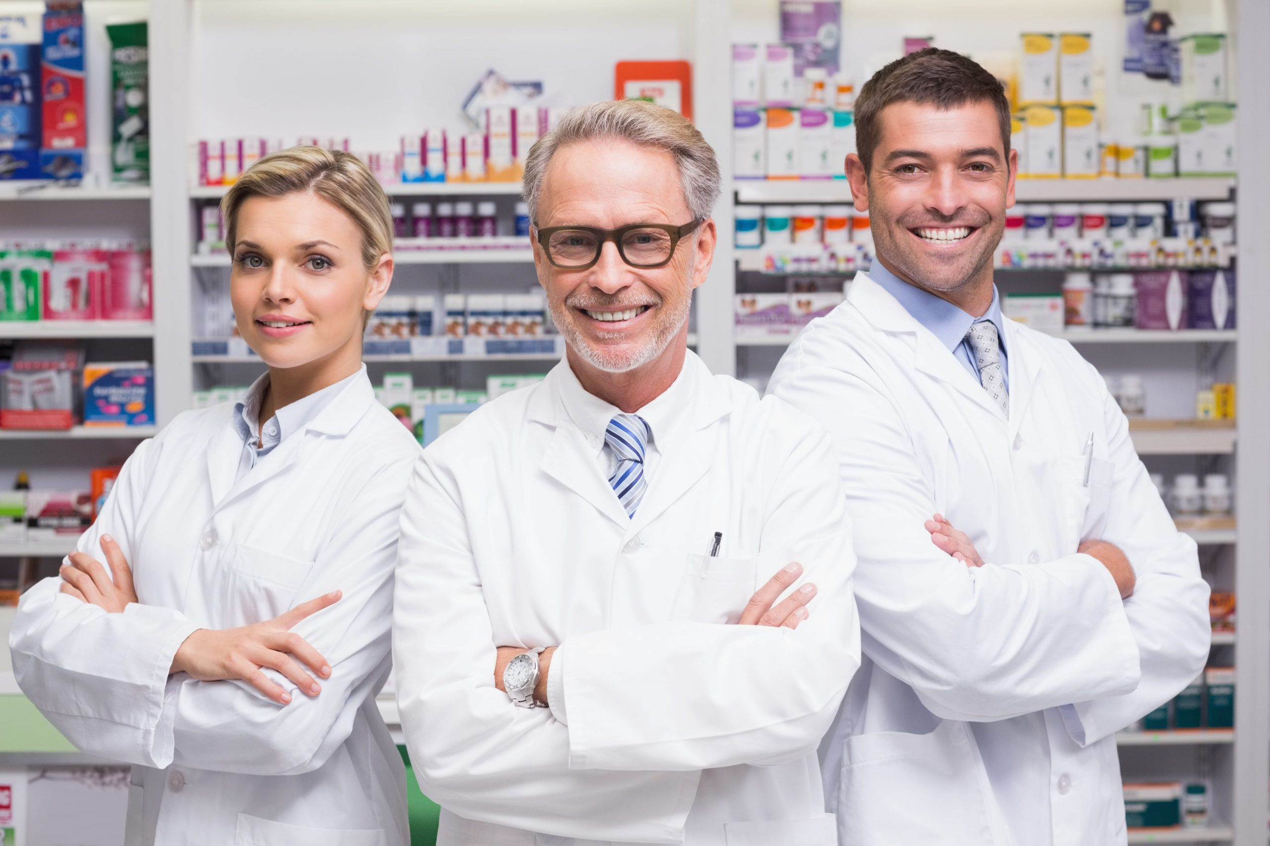 team-pharmacists-smiling-camera